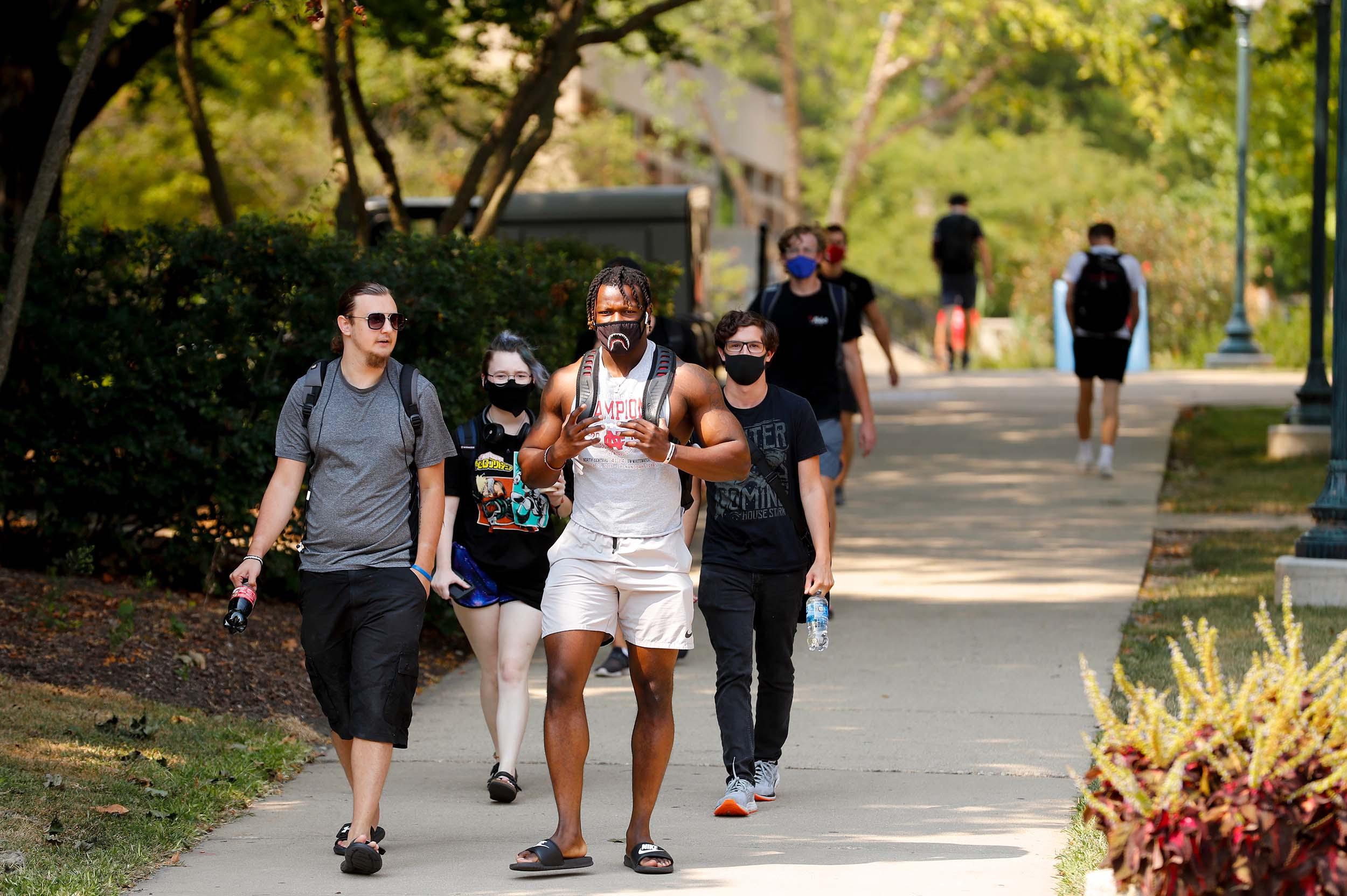 students walking down walkway
